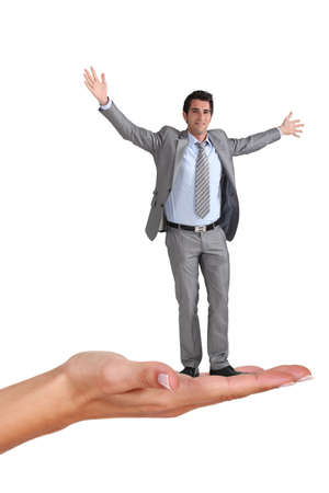 Businessman standing on a woman Stock Photo - 17219480