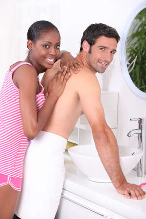 getting together: Couple in the bathroom