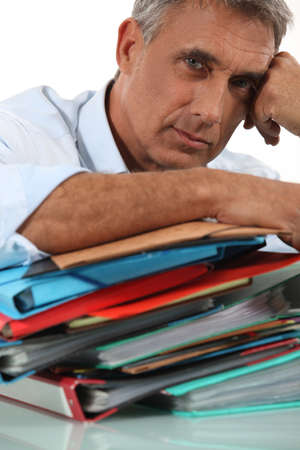 Man with pile of paperwork Stock Photo - 17220139
