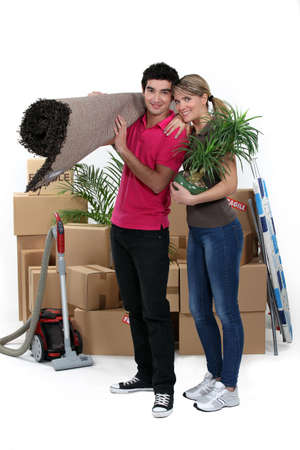 settling: couple arranging their new apartment