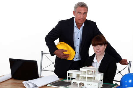 female architect in office with male counterpart photo