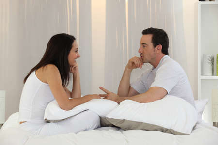 discuss: Married couple having an intimate discussion Stock Photo