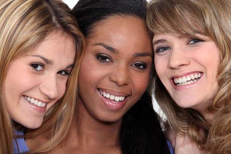 Closeup of three cheerful women photo