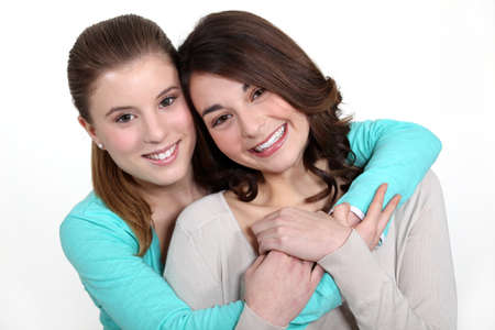 Two young women in a friendly hug photo