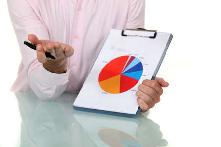 businessman showing pie chart at meeting photo