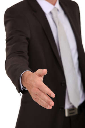 businessman giving a hand for a handshake Stock Photo - 17219787