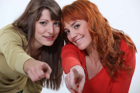 white playful: Friends pointing their fingers