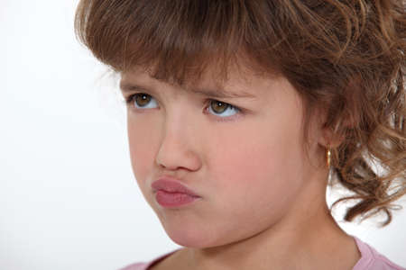 frustration girl: Little girl pouting Stock Photo