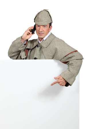 Man dressed in detective costume photo