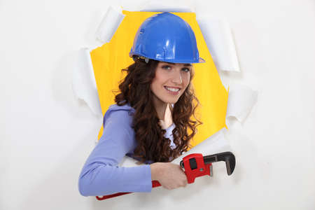 Female manual worker holding wrench photo