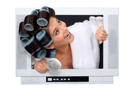 popping out: Woman popping out the TV with hairroller on