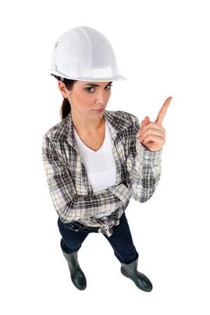 workwoman: Tradeswoman shaking her finger Stock Photo