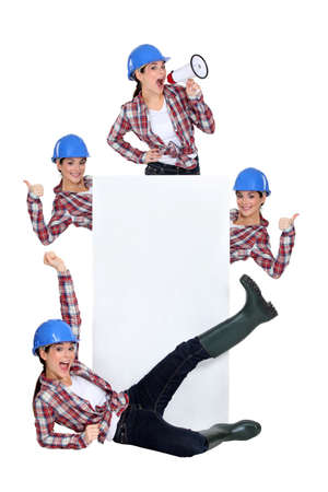 ebullient: Excited construction worker publicizing a blank board Stock Photo