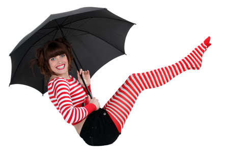 crazy girl: young woman in striped clothes holding an umbrella
