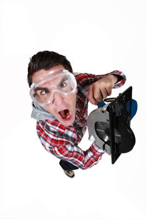frenetic: An impatient man using a circular saw Stock Photo