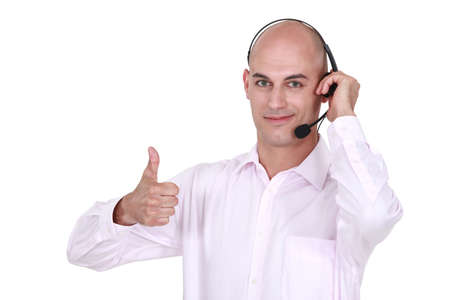 Man wearing headphones giving the thumb photo