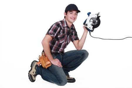 lumberman: craftsman holding an electric cutter Stock Photo