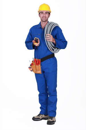 jumpsuit: Tradesman holding his tools and corrugated tubing
