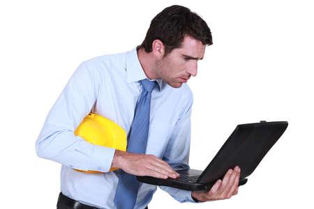 his shirt sleeves: Man looking at computer center