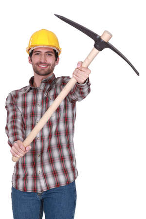 Tradesman holding up a pickaxe Stock Photo - 17220305