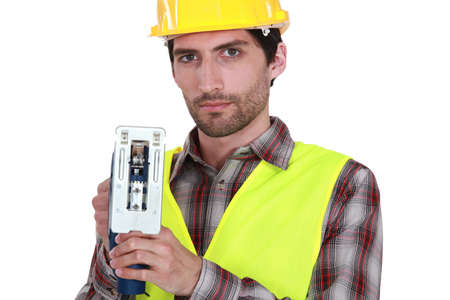 concentrates: A manual worker with a jigsaw