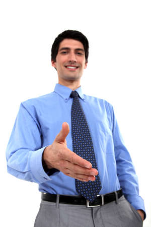 arm extended: Men shaking hands Stock Photo