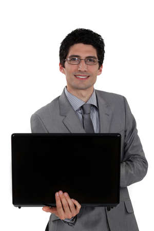 Glasses wearing businessman holding laptop Stock Photo - 17220016