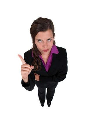 authoritative woman: Businesswoman shaking her finger Stock Photo