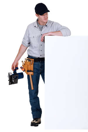 Tradesman admiring a blank sign Stock Photo - 17219900