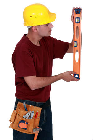 Tradesman displaying a spirit level Stock Photo - 17219856