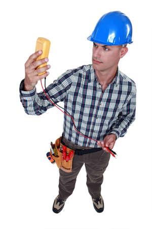 An electrician checking his voltmeter Stock Photo - 17219987