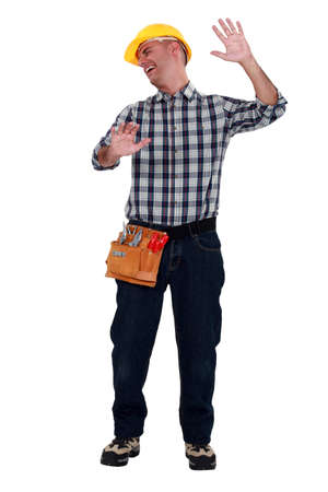banging: Tradesman banging into a see-through glass barrier Stock Photo