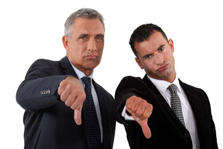 disapproval: businessmen, thumbs down Stock Photo