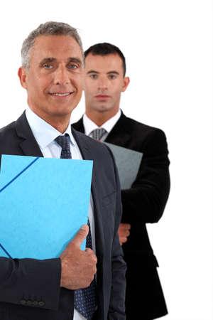 esteemed: Older and younger businessmen