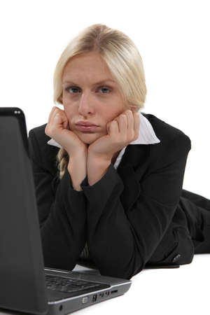 Glum woman with her laptop