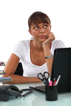 botch: cute female student with computer looking pensive Stock Photo