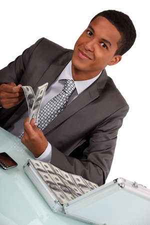 commercial activity: Businessman with a briefcase full of money