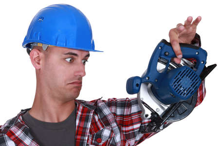 Builder holding circular-saw Stock Photo - 17220131