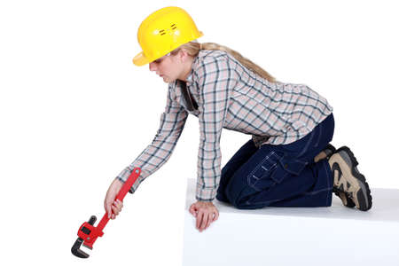 engineer's: Blond plumber using adjustable wrench