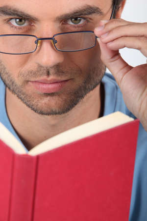 cut off head: Man with glasses reading Stock Photo