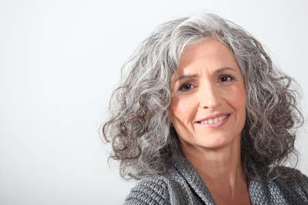 frizzy hair: Grey-haired woman on white background