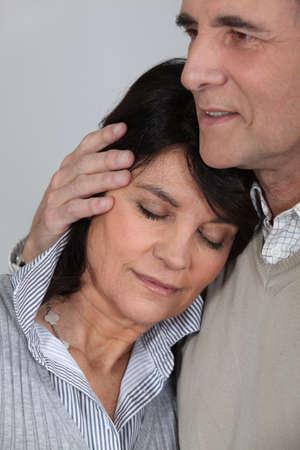 Man comforting his wife photo