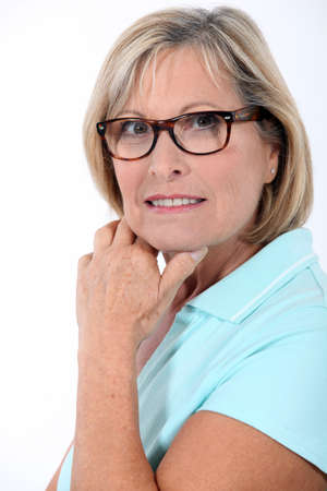 fifty: Older woman wearing glasses