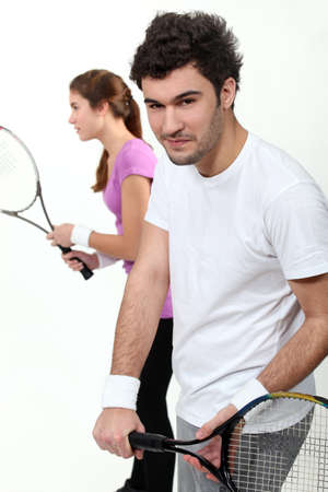 Couple playing tennis Stock Photo - 17219999