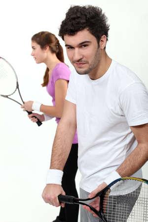 Couple playing tennis Stock Photo - 17219999