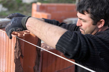 bricklayer: A bricklayer busy at work