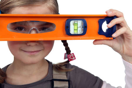 kidding: Girl with a spirit level Stock Photo