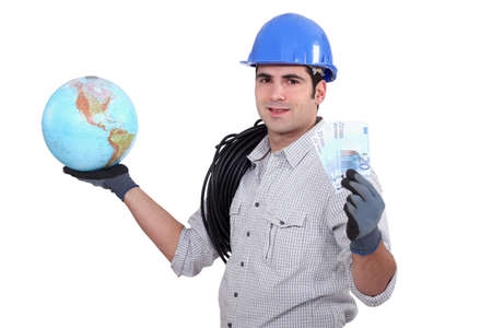 Electrician holding globe and cash photo