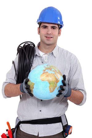 craftsman holding a globe Stock Photo - 17304411