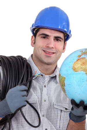 Electrician wiring the world Stock Photo - 17304467
